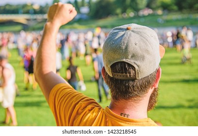Entertainment concept. Visit summer festival. Guy celebrate holiday or festival. Summer fest. Man bearded hipster in front of crowd. Book ticket now. Open air concert. City day. Music festival.