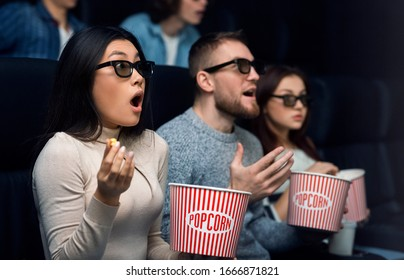 Entertainment and leisure. Shocked audience watching scary movie in cinema