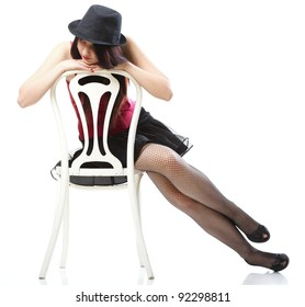entertainment pastime girl dance in red corset chair white isolated showgirl,