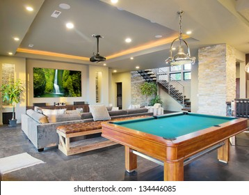 Entertainment Room in Luxury Home with Movie Screen and Pool Table