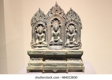 Enthroned three Buddhas in the gesture of touching earth ,Thai sculpture.