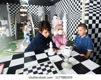 Enthusiastic children play in the chess quest room