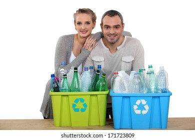 Enthusiastic couple recycling