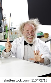 Enthusiastic eccentric senior scientist in his lab points up excited about ideas. High key, vertical, copy space.