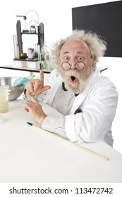Enthusiastic eccentric senior scientist in his lab, points up excited about ideas. High key, vertical, copy space.