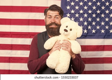 The enthusiastic spirit. Patriotic man holding teddy bear on independence day. Bearded hipster being patriotic for usa. Patriotic feelings.