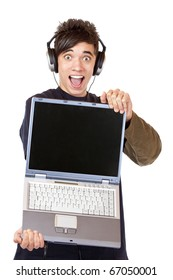 enthusiastic Teenager with earphones and computer recommends mp3 music download portal. Isolated on white background.