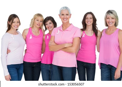 Enthusiastic women posing with pink tops for breast cancer on white background