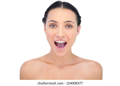 Enthusiastic young model posing on white background