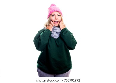 Enthusiastic young woman stands happy in warm home clothes isolated on white background. Has recovered from a flu, absence of temperature.  Modern concept of health, self-care, treatment.