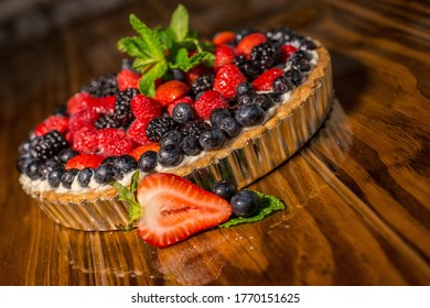 Entire berry tart strawberries blueberries and blackberries