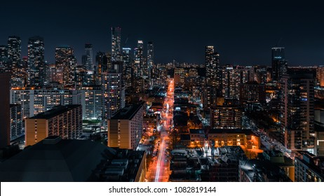 Entire futuristic city skyline view of the Yorkville neighbourhood in North Toronto Canada. Modern buildings, urban architecture, cars travelling. construction and development.