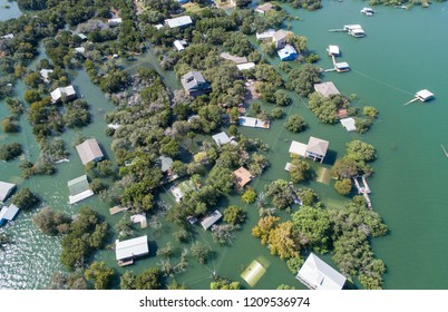 Entire neighborhood flooded and destroyed by rising water level , at lake travis graveyard point - Historic Flooding aerial drone view above Homes and Houses under water after Central Texas Flooding