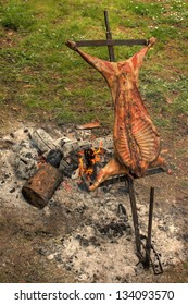 Entire Roasted Lamb on a Spit over open Fire during Easter Holidays