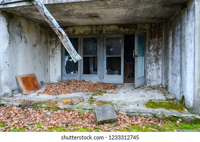 Entrance of 9-storey building in abandoned ghost town of Pripyat in Chernobyl NPP alienation zone, Ukraine