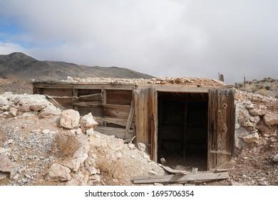 An entrance to an abandoned mine shaft.