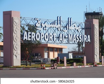Entrance to airport in AGADIR city in MOROCCO with clear blue sky in warm sunny winter day. Arabic words means: Al Massira Airport, AFRICA on FEBRUARY 2017.