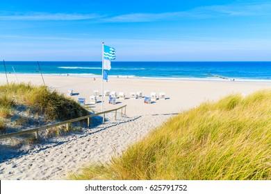 Entrance among grass sand dunes to Kampen beach, Sylt island, North Sea, Germany