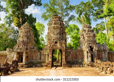 Entrance to ancient Preah Khan temple in Angkor, Siem Reap, Cambodia. Mysterious gopura on woods background. Angkor is a popular tourist attraction.