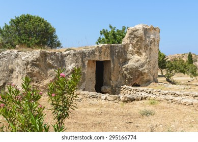 Entrance to an ancient stone burial tomb at an archaeological site in Paphos, Cyprus.