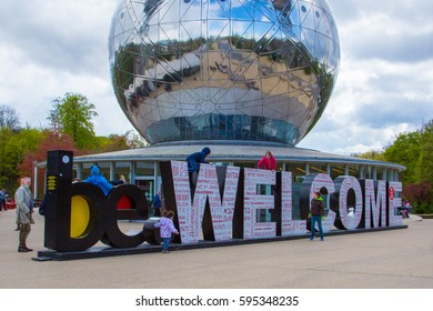 Entrance to the Atomium - a building in Brussels originally constructed for Expo 58, the 1958 Brussels World's Fair. Huge Welcome letters in front of the building. be WELCOME to Brussels and Atomium