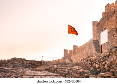 Entrance of Ayasoluk Castle with turkish flag and white board in Selcuk near Ephesus in turkey