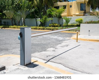 Entrance barrier gate to parking lot of caribbean house