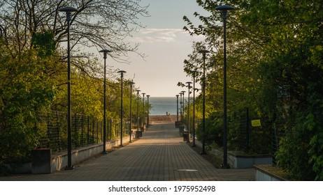 Entrance to the beach on the Stogi beach, Gdansk, Poland. Baltic Sea. Sunrise.