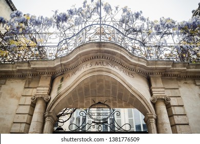Entrance to the building of the municipal archives of Bordeaux with its spring glycine