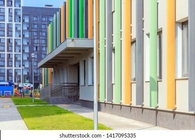 Entrance to building. Staircase with metal railing. Entrance group in small ofice and colorful facade. Stair steps up and down. Kindergarten, school or hospital. Main entrance. Moscow 2019