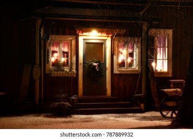 Entrance to a cafe in a village in Smaland, Sweden, on a winter evening. On the right an old sleigh.