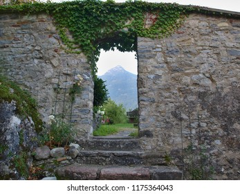 entrance to the castle garden, view of the Alps