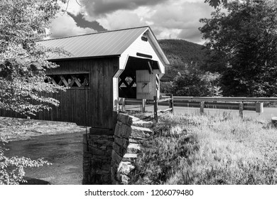 Entrance to a covered bridge in Vermont, New England America on a sunny summer day in black and white.