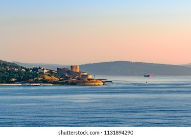 Entrance to Dardanelles (Canakkale strait) in morning haze from Aegean Sea with Ottoman fortress Kilitbahir ahead