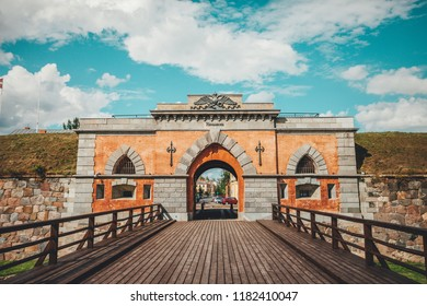 Entrance to Daugavpils fortress in Daugavpils, Latvia, wooden bridge and entrance in castle, summer day.