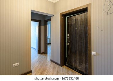 Entrance door to the apartment and interior doors to different rooms, view from the corridor