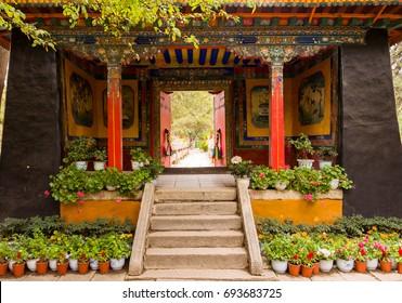 Entrance door to colorful gardens in Norbulinka monastery, Tibet