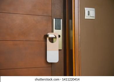 Entrance door of hotel room with empty sign please do not disturb