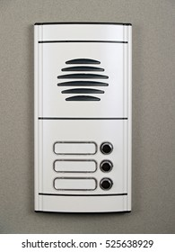 Entrance door intercom on gray background