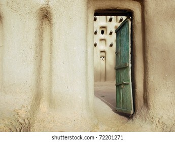 An entrance door into a mud mosque in a Dogon village in Mali