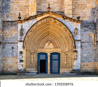 Entrance door and main facade of old stone church in Guernica, Basque Country, Spain. Romanesque architecture concept. Religion and faith concept. Facade of antique castle in Europe.