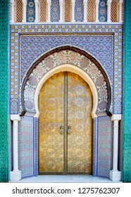 Entrance door with mosaic and brass door at the Royal palace in
