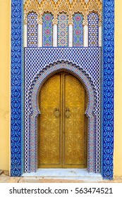 Entrance door with mosaic and brass door at the Royal palace in Fez Morocco