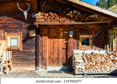 Entrance door to old wooden cabin at mountain meadow in the austrian alps, Zillertal Austria