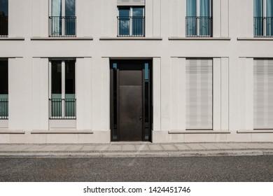 entrance door on modern building  with empty street - house door