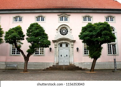 entrance door and part of the facade of the lutheran church St. Nicolai in Gifhorn, Germany