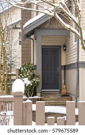 Entrance door of residential townhouse on winter time