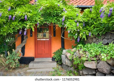Entrance door of traditional colorful half-timbered house in Allinge, Bornholm, Denmark