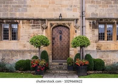 entrance Door of Traditional Old English Cottage in the Country with Flowers and Gardens