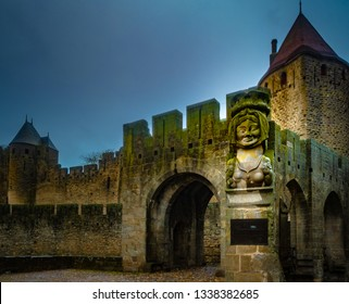 The entrance of the drawbridge in Cite Carcassonne with lady Carcas's bust, Carcassonne France